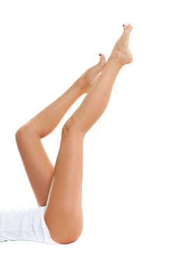 Long woman's legs with smooth skin after depilation.