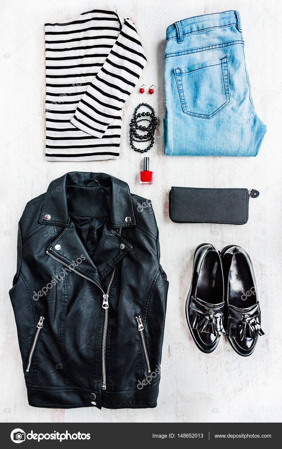 af06a966 Urban style woman collage clothing. Top view of a leather jacket, striped  blouse,