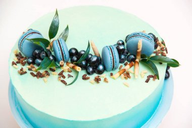 Blue cheesecake with macaroons for party, top view. Happy Birthday party celebration concept.