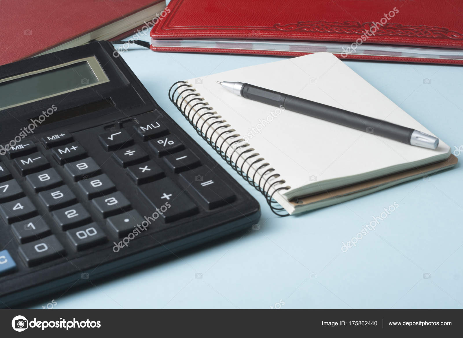 home savings budget concept calculator pen and accounting books