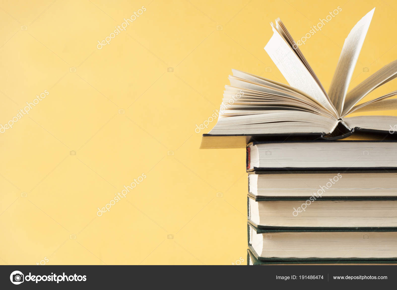 open book on stack of books on wooden table education background