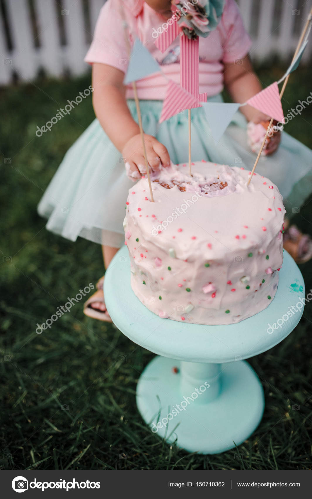 A Birthday Cake For The First Birthday Of The Girl Girl Hands T