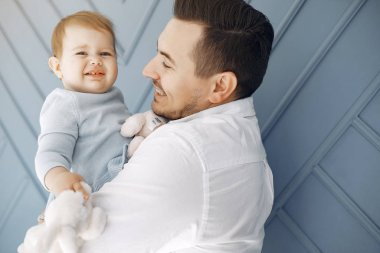 Father and little daughter have fun at home