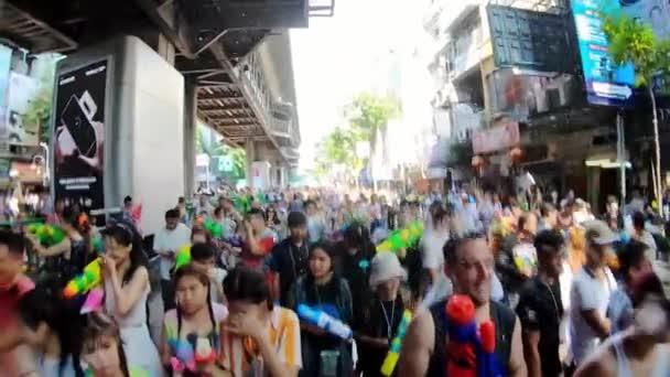 Bangkok, Thailand-April 14, 2019: Locals and tourists celebrate Songkran