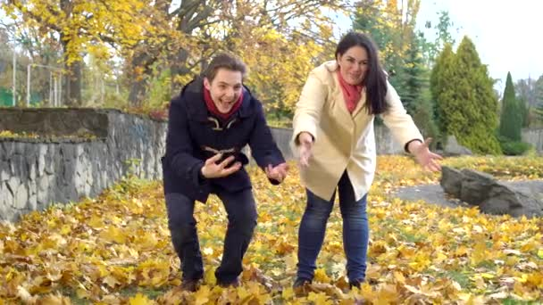 Happy family walking  in the park in autumn. Parents and two dau