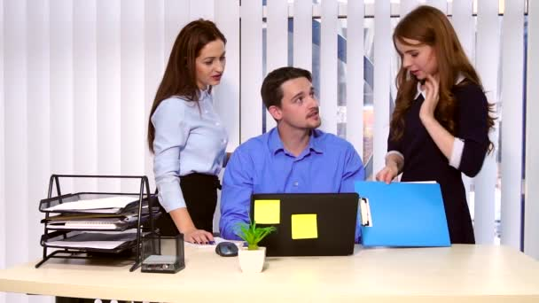 Business team communicates with the laptop in hands.