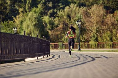 A girl jogging in the park.