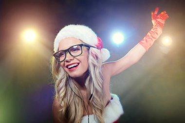 DJ girl in Santa Claus costume for Christmas