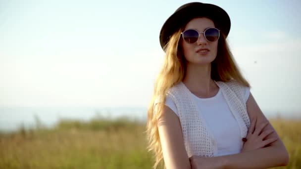 833ba5b796 Young beautiful woman model in hat and sunglasses posing outdoor slow  motion– stock footage
