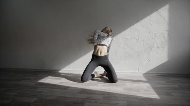 Young woman dancer dancing contemp moves in the studio slow motion