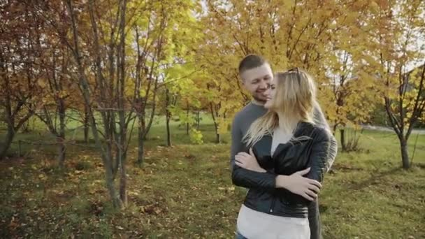 Young couple on a date in the autumn park