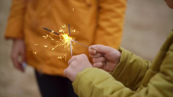 Child with burning sparklers outdoor