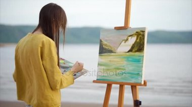 Abstract oil picture of landscape and female painter at work. Creative person