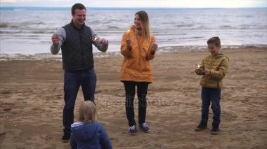 Family with sparklers by the sea
