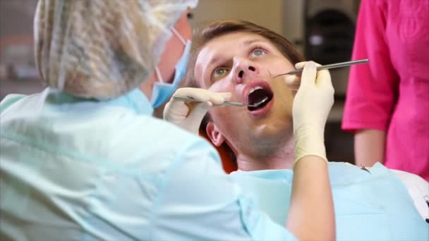 Dentist examination scene. Male patient and female dentist