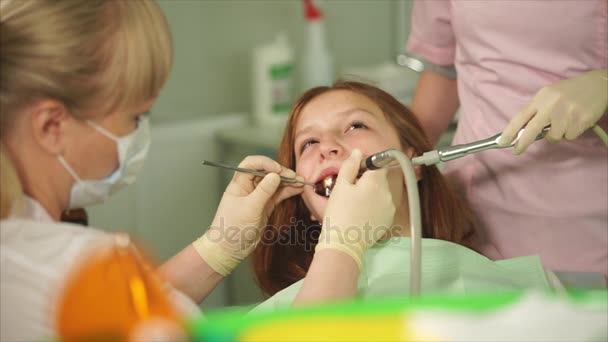 A dentist who did a tooth brushing in a teenager in a dental clinic