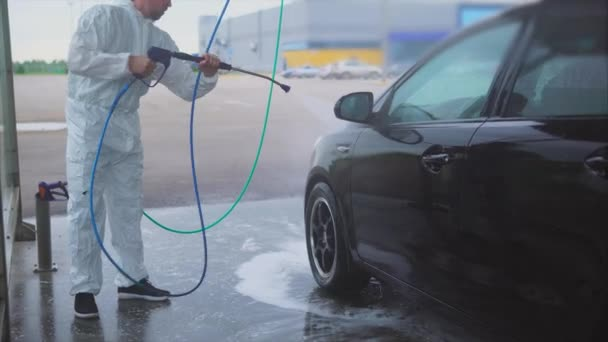 Spray Car Wash >> Man Washing His Car With Water Spray Car Wash Self Service