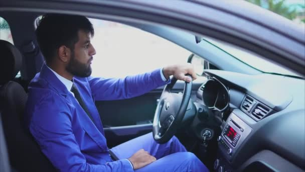 Handsome young muslim man driving the car and looking at the road.