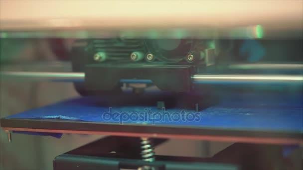 3D printer prints the form of molten plastic detail. Three dimensional printer