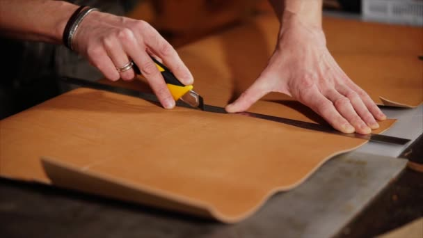 Cutting process of a handmade production accessories from leather ...