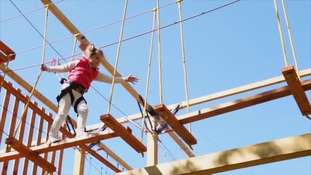 Girl having active leisure in adventure park