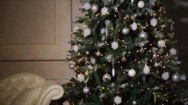 big decorated christmas tree is standing in big hall of house in night panorama - Videos Of Decorated Christmas Trees