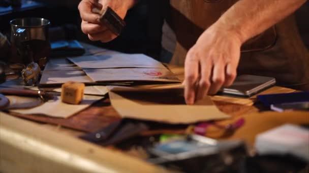 Man seals craft paper in a studio