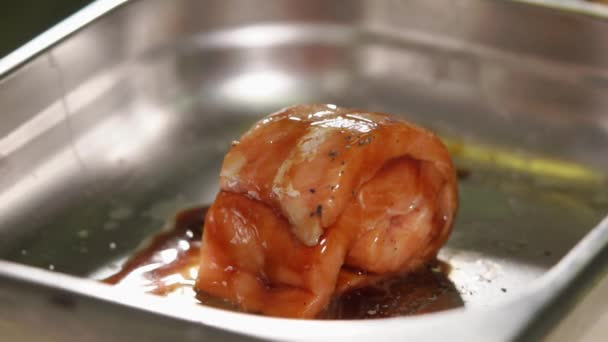 Uncooked slice of fish covered with sauce