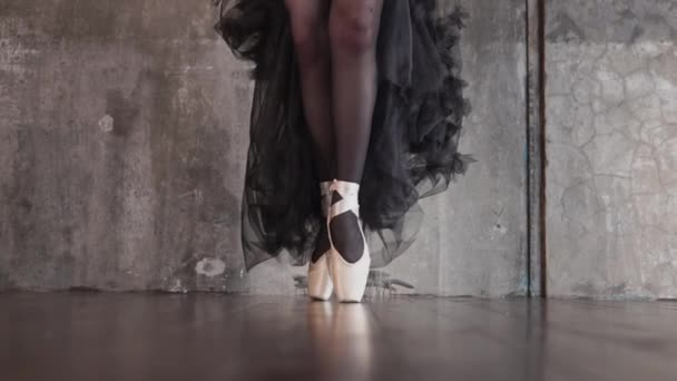Ballerina is standing on pointes and moving to camera , close-up