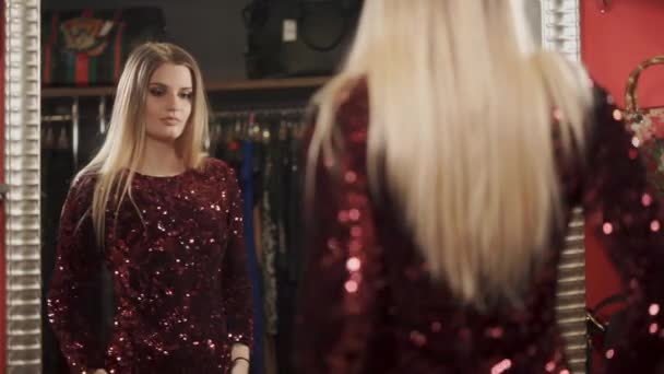 stylist trying on dress from the latest collection, the lady looks in the mirror