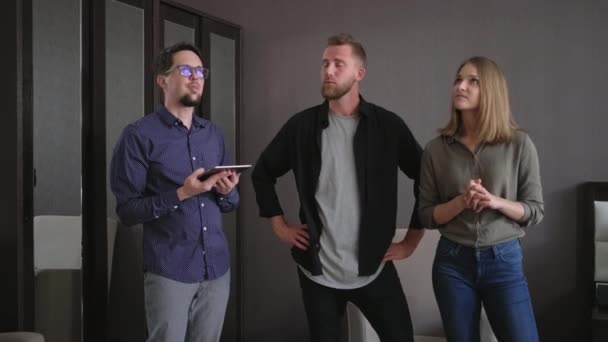 Real estate agent and potential buyers in the apartment