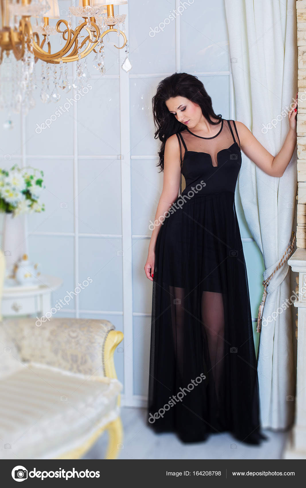 Young successful woman or teenager in evening black dress. Prom ...