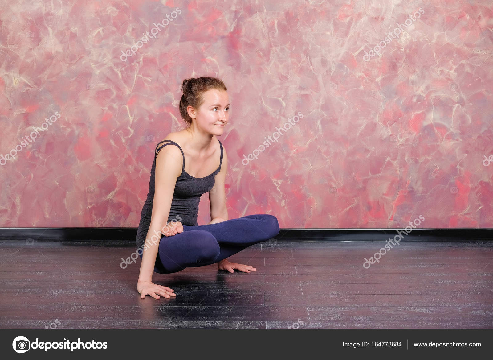 Asana In Yoga Stand On Hands Parshva Bakasana Healthy Lifestyle The Girl Is Practicing Meditation In Yoga Class Relaxation And Stretching Stock Photo C Eve134lin Gmail Com 164773684
