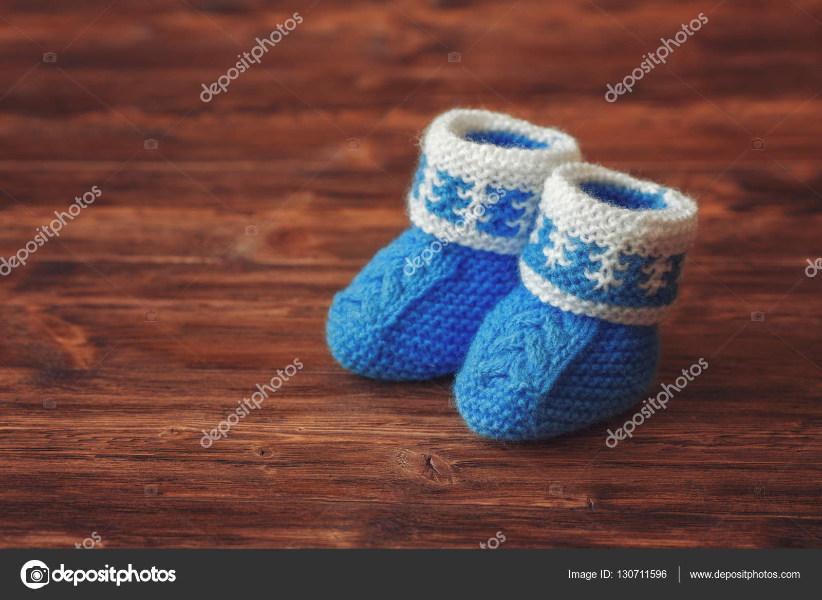 046306c68bff2 Blue crochet baby booties on wooden background, copyspace, vintage ...