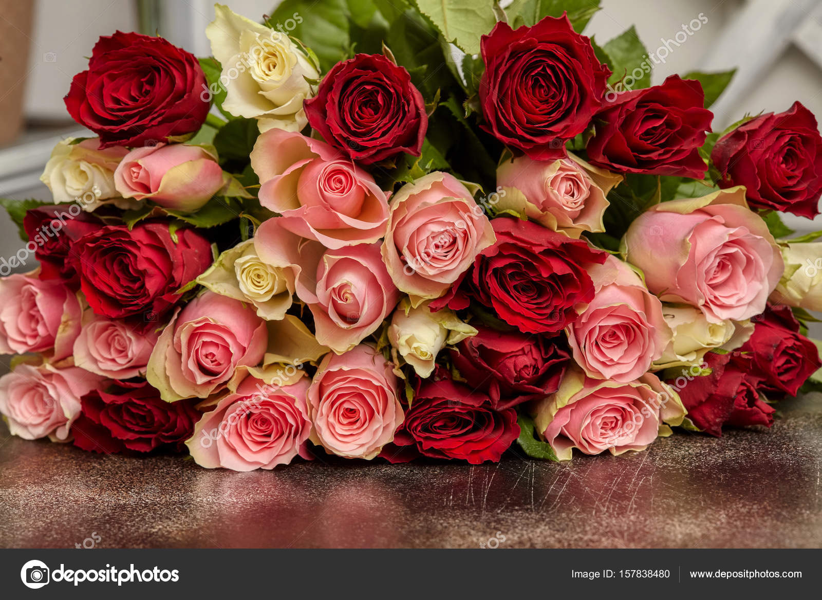 Big bouquet of multicolored roses on table stock photo hdtexx big bouquet of multicolored roses on table stock photo izmirmasajfo