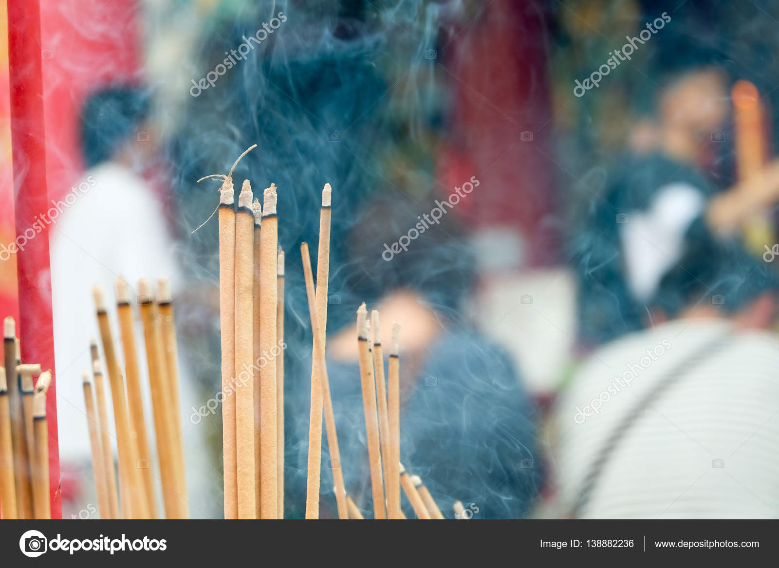 Incense joss stick burning slowly with fragrant smell smoke