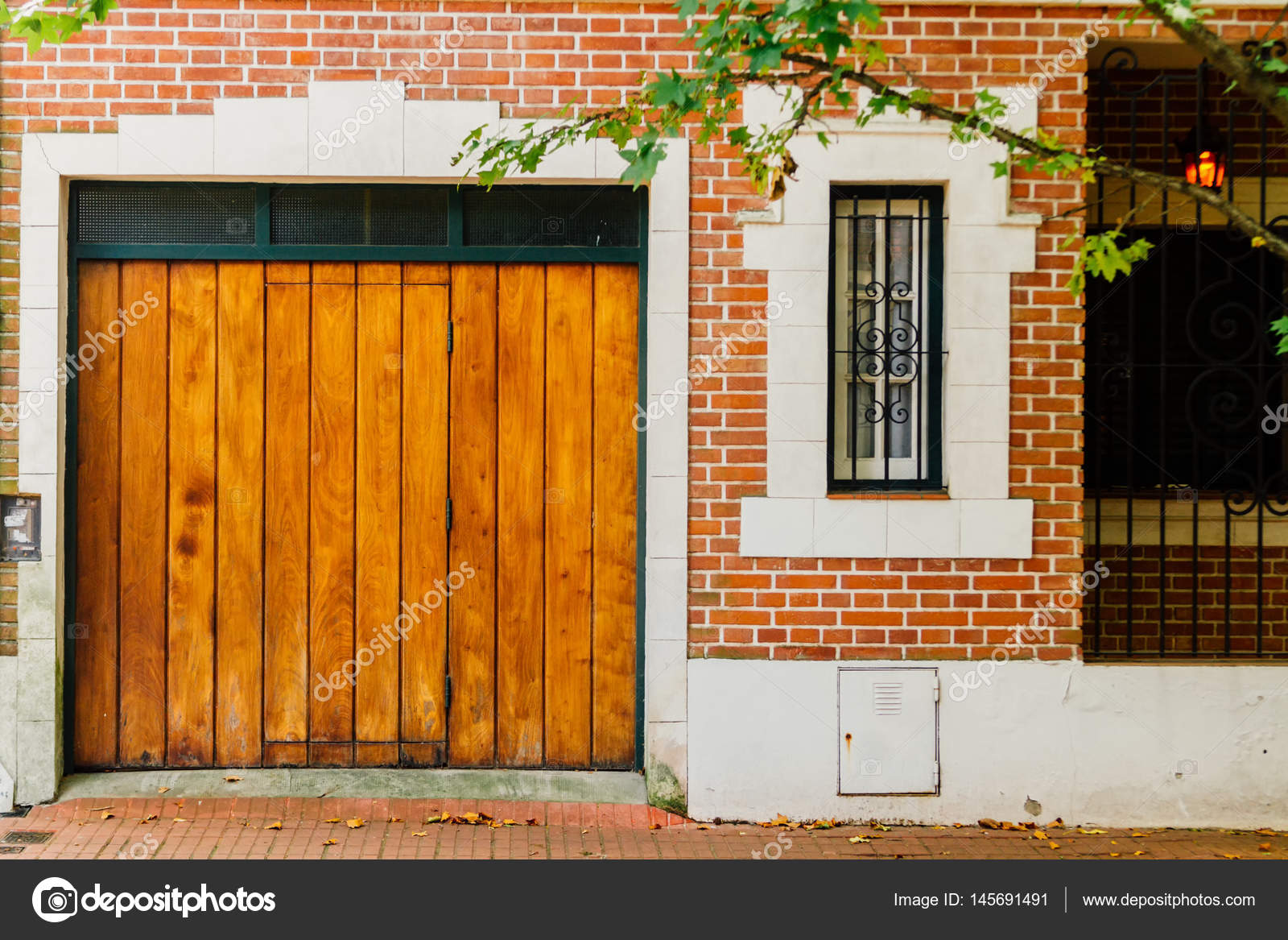 Wooden Gate With Window At The Entrance Of A House Stock Photo