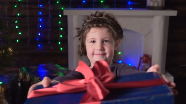 Girl shows christmas gifts and smiles– stock footage