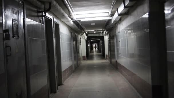 walk down an endless hallway in a creepy