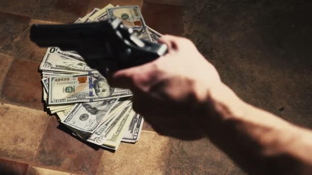 pénzt, és egy revolvert. Büntetőjogi fogalom