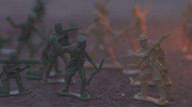 toy model soldier in the fire. The concept of the death of war. slow motion