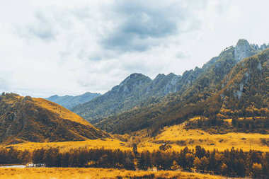 Scenery of Altai mountains with meadows during autumn