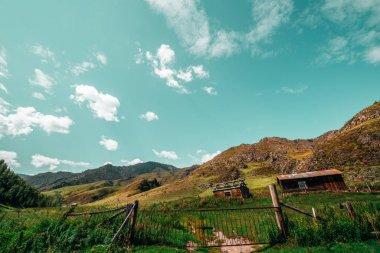 Two forsaken houses in mountains