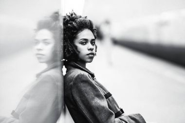 Greyscale portrait of black girl at the metro station
