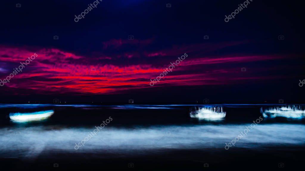 boats in ocean at night