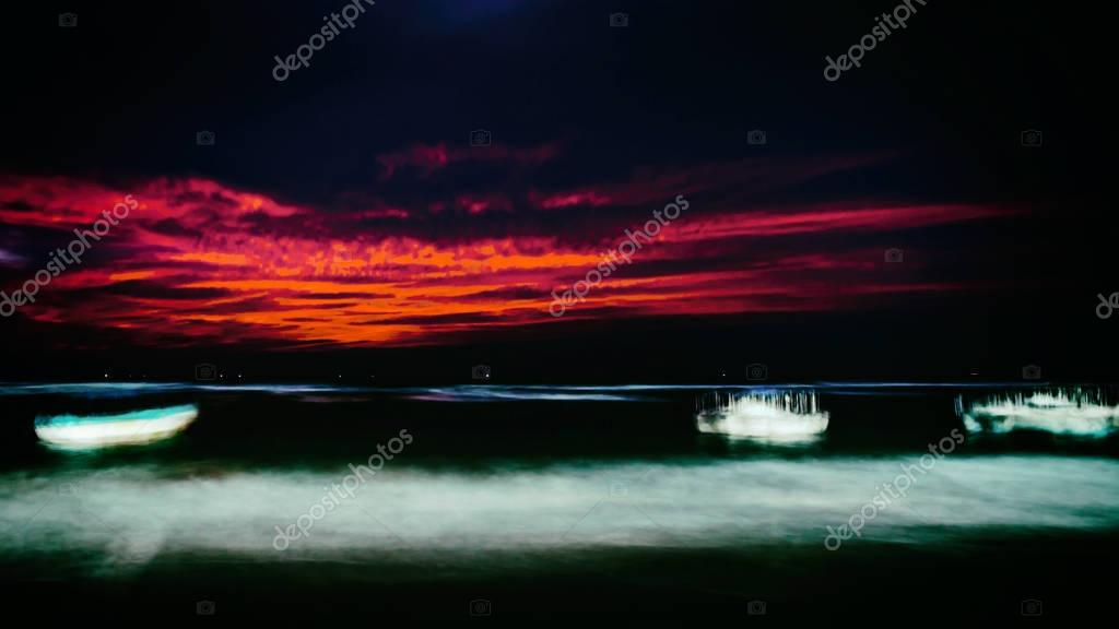 boats in ocean at night