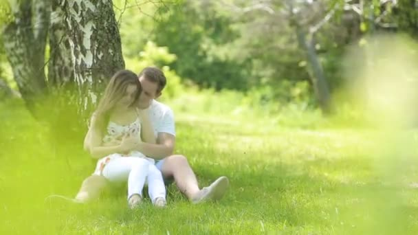 Young couple having fun on the green field in the spring or summer, general plan