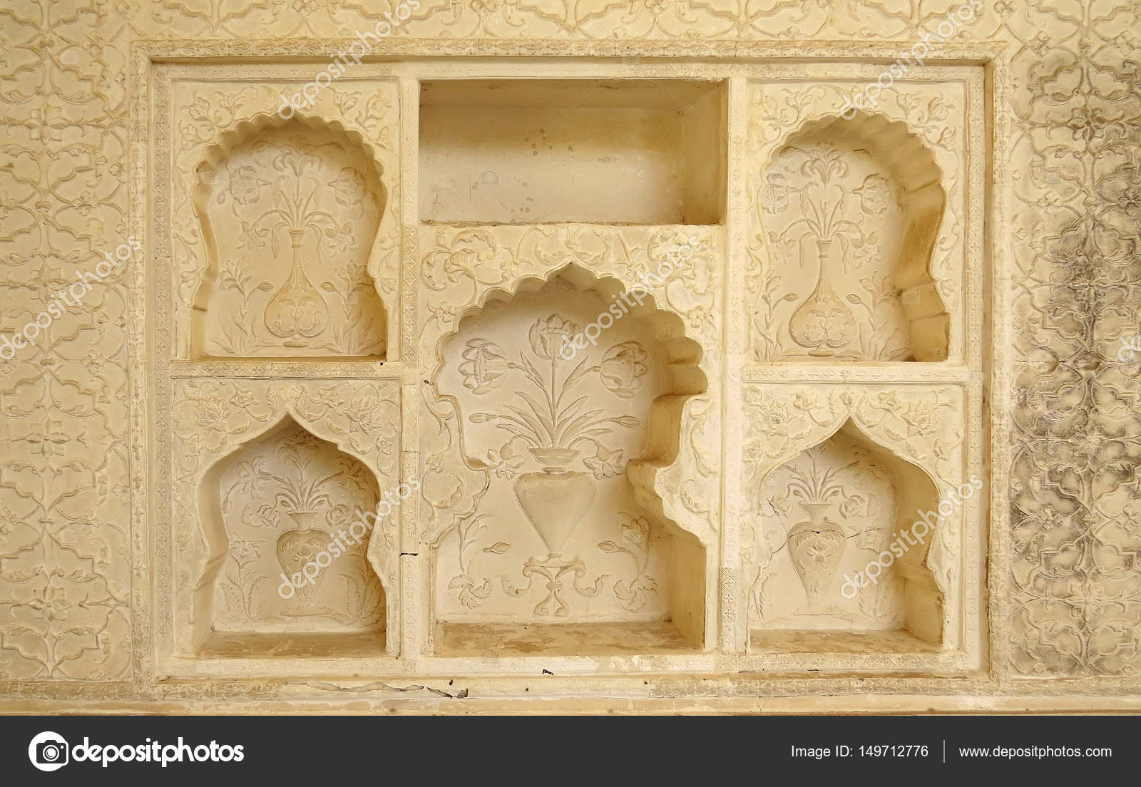 The niche-decorated wall of one of the parts of the ancient palace ...