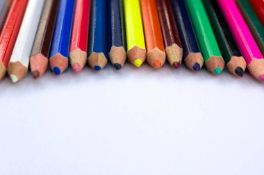 White background for presentation slides with colourful pencils