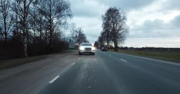 4K Footage Aerial View to the White Car on the Rural Road to Riga, Latvia